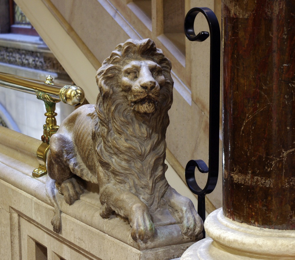 Magnificent lion on the stairs
