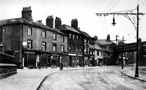 """Kirkgate as seen from outside the Parish Church, 1909"""