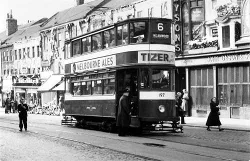 Lower Briggate showing tram no. 197, a 'Horsfield' built 1930-31, heading to Meanwood. All the shops are decorated to celebrate the coronation of Queen Elizabeth II (2 June 1953)