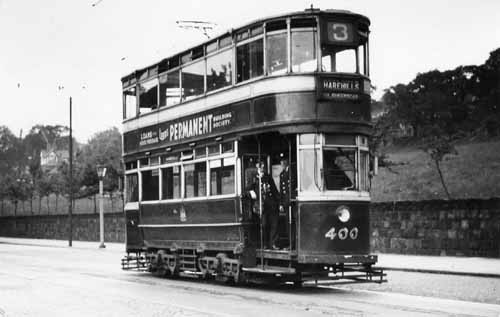 Tram no. 400 at Kirkstall Abbey terminus on Abbey Road, bound for Harehills on route no. 3. The grounds of Abbey House Museum are behind the wall in the background (22 June 1948)