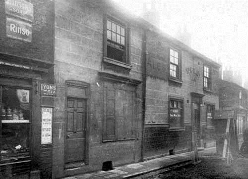 Ellerby Lane: Nos.46-48. 27th January 1928. On the left, shop business of Thomas Hazelgrave selling a variety of goods. Moving right number 50 has shuttered window. The Yew Tree Inn, numbers 46 to 48, licensee Mrs Mary Jane Stringer. There are road works outside the pub