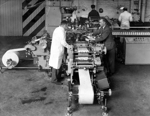 c1960s. Interior view of the fitting shop at Job Day & Sons Ltd., packing machinery engineers, of Beeston Royd works on Beeston Ring Road. It shows a tea packing machine being tested before delivery to customers. These machines were sold world wide. The fitting shop foreman, Jack Stobart, is in the foreground wearing a white coat. The suited man, opposite him, is the boss, Mr. Nailor. The two fitters in the background are, left, John Binks and right, Lorrie Mugg