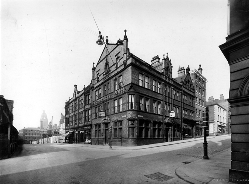 14th October 1928. Image shows the corner of Albion Street and Guildford Street with the Commercial Hotel on the corner, and Guildford chambers to the left. The road was renamed as The Headrow after widening took place in the 1930s but this section was formerly known as Guildford Street. In the background, left, building work is in progress on the Leeds Permanent Building Society site, Permanent House, at the corner with Cookridge Street, now part of The Light. Text and image taken from Leodis