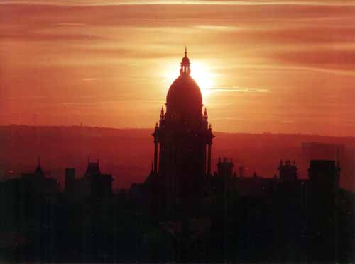c1990s Image shows the sun setting, highlighting the dome of Leeds Town Hall.