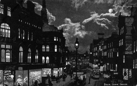 View of Boar Lane by night from a postcard with postdate 23 February 1904. The view looks east with Lockhart's Cafe on the left and London Dentistry and the Grand Restaurant on the right.
