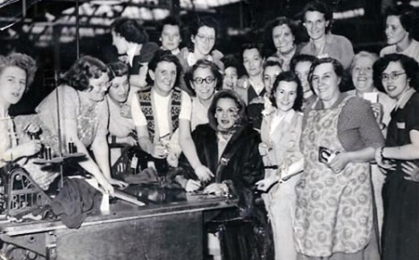 Early 1960s. Image shows some of the female workforce of John Collier's (remembered by many as Prices Tailors Ltd. although it was sold in 1954) as they cluster around celebrity and glamorous film star, Patricia Medina. Taken from our archive of historic photographs - www.leodis.net. You can also browse sets of photographs on subjects such as arcades, parks, public houses, shopping and cinema at www.leodiscollections.net