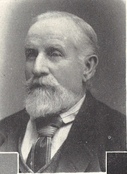 Photograph of James Bywater, a bearded middle-aged man, wearing a smart suit and tie.