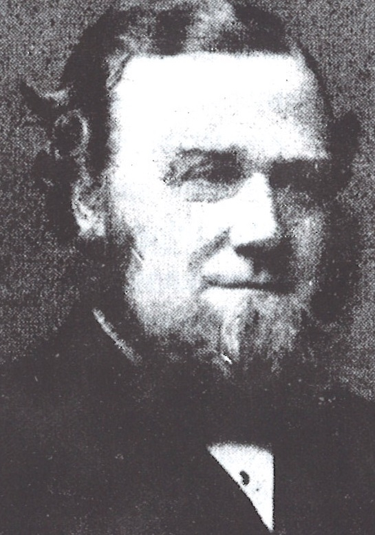 Photo of Israel Roberts, a middle-aged man, with a beard but no moustache. He is wearing a smart suit.