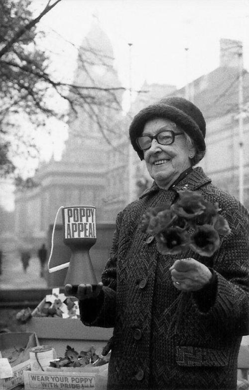 7th November, 1976. Image shows ex-servicewoman and veteran poppy seller for 54 years, 81 year-old Annie Tunnington.