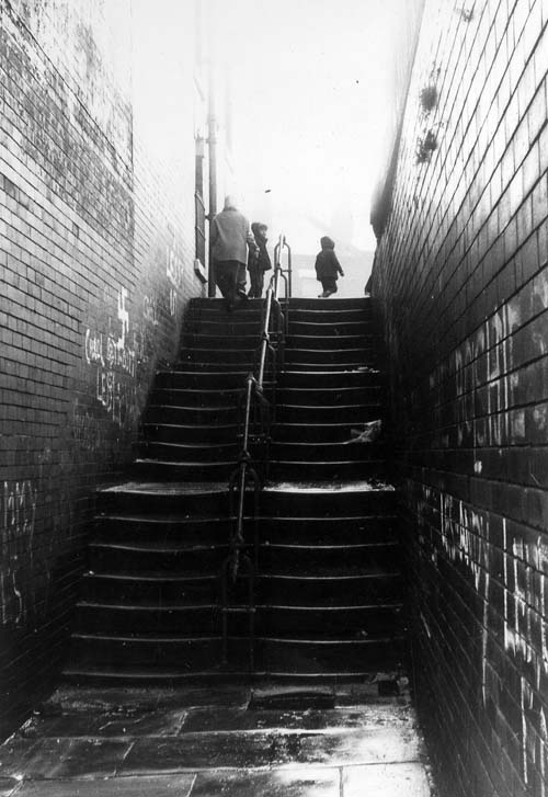 1970. View shows a flight of steps leading up from Servia Hill (formerly New Camp Road) to Grosvenor Hill (formerly Camp Road), all in Woodhouse. From www.leodis.net, (c) Leeds Library and Information Service