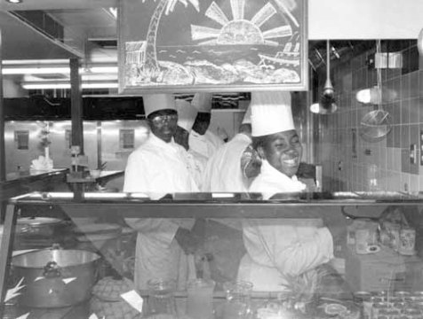 December 1989. View of staff behind the counter of Dr. B's Caribbean Restaurant.