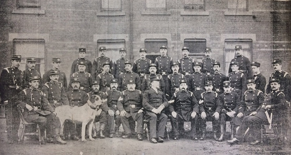 Photograph of the Leeds Corporation Fire Brigade with Baker in centre and Barney the fire dog.