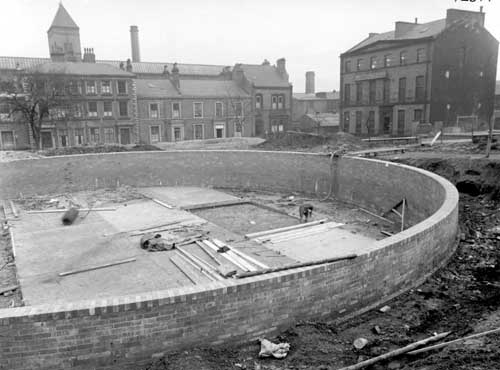 26th November 1941. View of water tank under construction, looking to the south of the square, Swarthmore Education Centre can be seen (c) Leeds Libraries