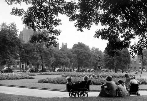 22nd August 1951. View of Park Square on a summer's day where a woman and several children are relaxing, towards the south-west corner (C) Yorkshire Post