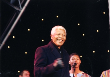 30th April 2001. Nelson Mandela smiles warmly as he addresses the many thousands of people who have assembled in Millennium Square for the historic occasion of his visit to Leeds (C) Leeds Libraries