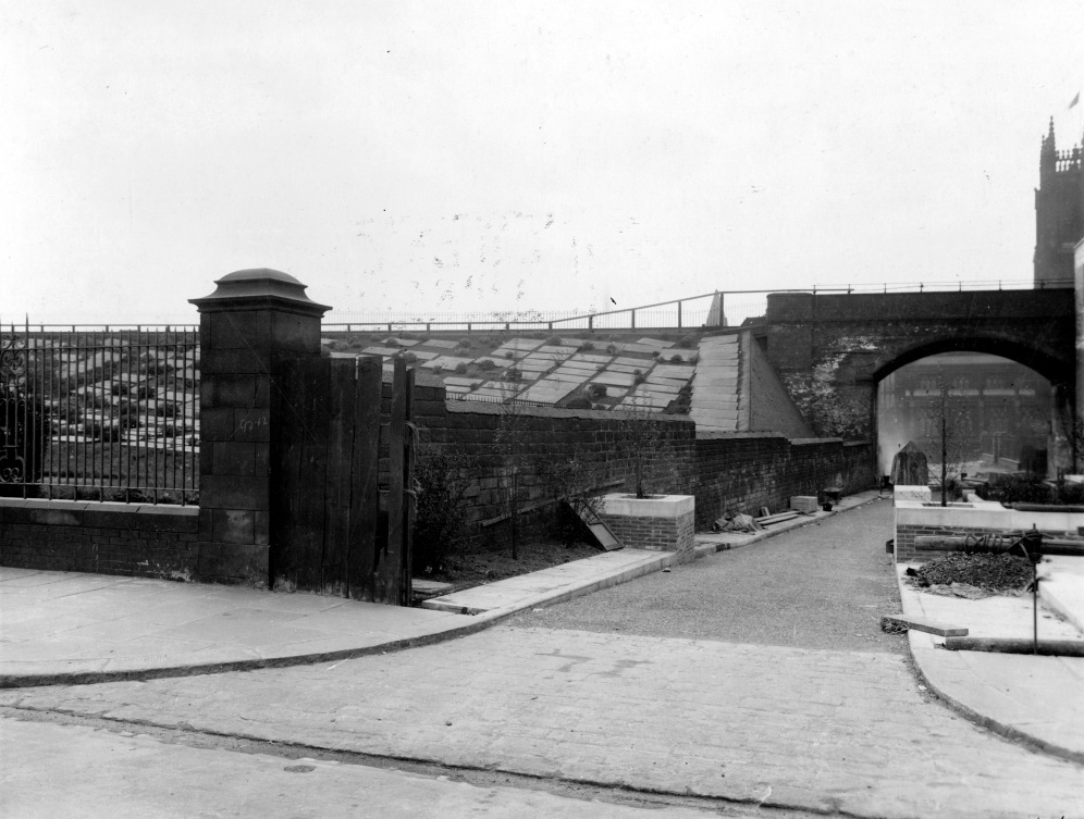 29th April 1938. View of Church Lane showing railway viaduct with Leeds Parish Church and Kirkgate in the distance (C) Leeds Libraries