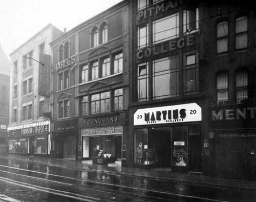 Black and white photograph showing Youngman's Fish Restaurant in centre of row of shops on New Briggate.